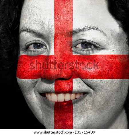 Woman with flag painted on her face to show England support in sports
