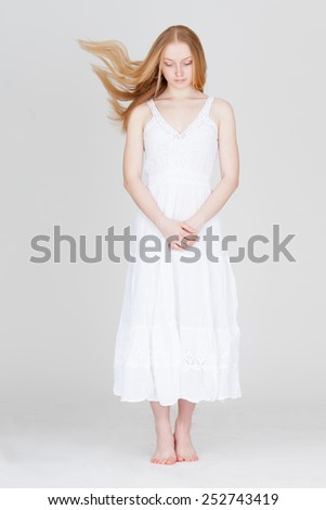 woman with flying hair wearing white dress - stock photo