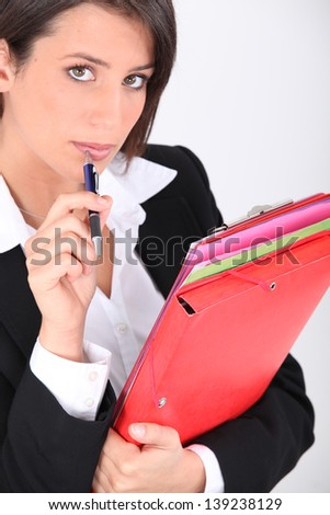 Woman with folders and pen - stock photo