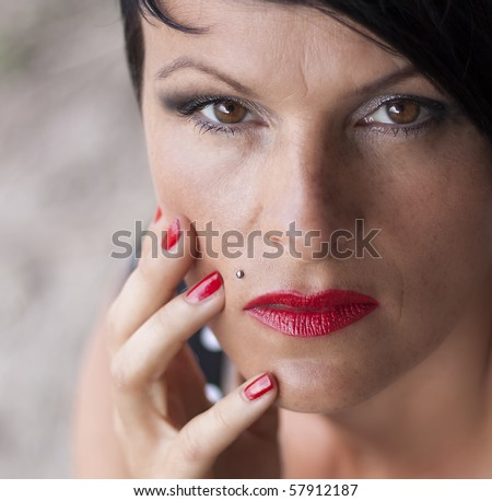 Woman with fred lipstick and red nail polish - stock photo