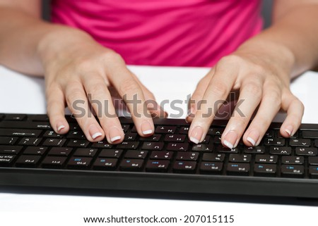 Woman With French Manicure Typing On A Black Keyboard