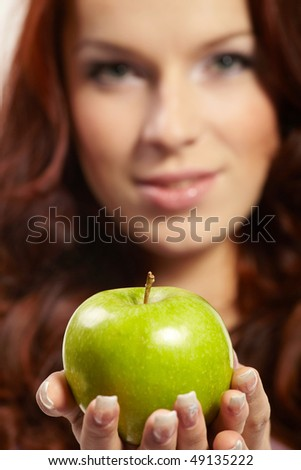 woman with fresh apple