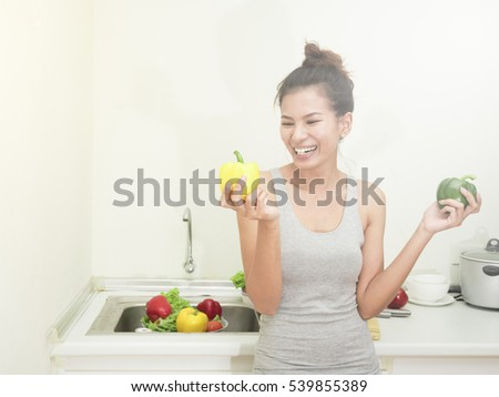 Woman with fruits and vegetables in the kitchen.