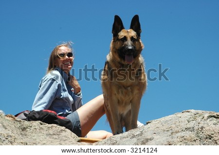 Woman with German Shepherd dog - stock photo