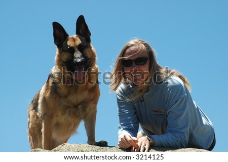 Woman with German Shepherd dog
