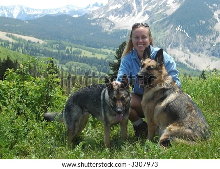 Woman with German Shepherds