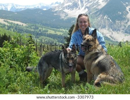 Woman with German Shepherds - stock photo