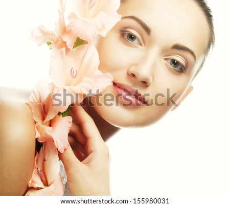 woman with gladiolus flowers in her hands - stock photo
