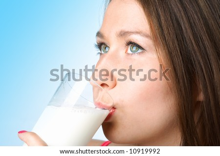 woman with glass milk on blue background - stock photo