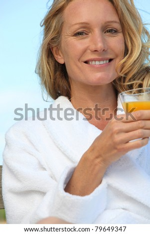 Woman with glass of orange juice - stock photo
