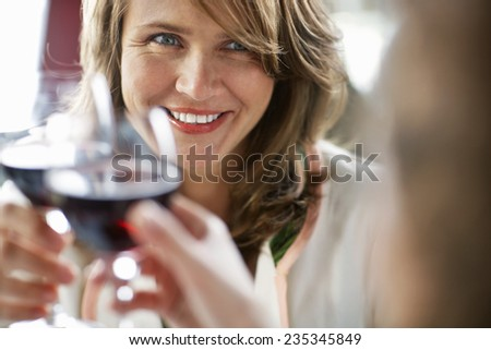 Woman with Glass of Red Wine - stock photo