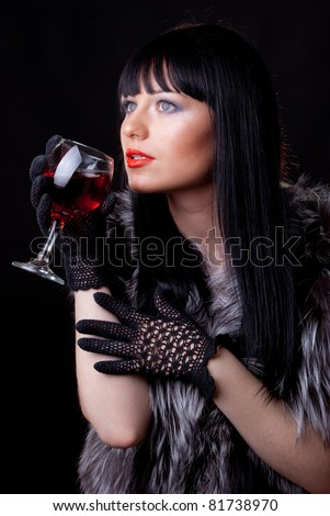 Woman with glass of red wine on black - stock photo