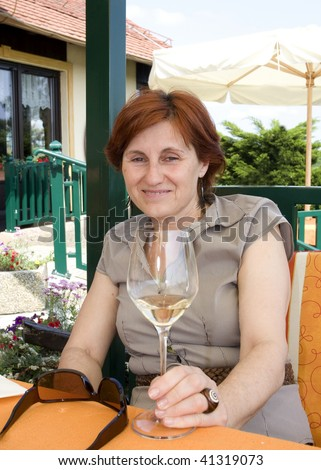 woman with glass of wine - stock photo