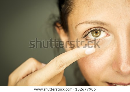 woman with glasses and contacts - stock photo