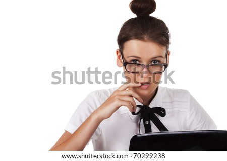 Woman with glasses sits and working on laptop A series of office work