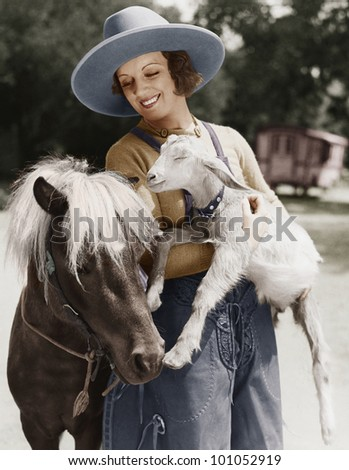 Woman with goat and pony - stock photo