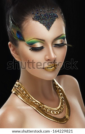 Woman with golden makeup