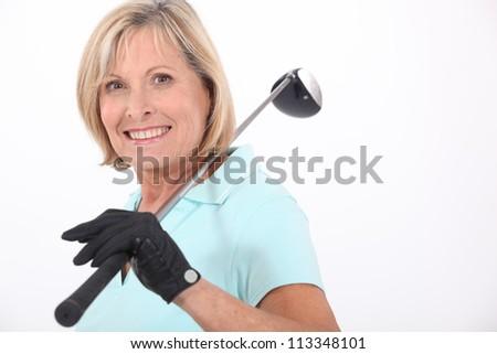 Woman with golf club - stock photo