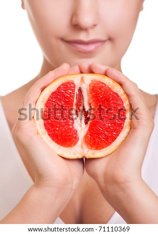 woman with grapefruit in hands close-up - stock photo