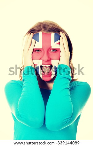 Woman with Great Britain flag painted on face. - stock photo
