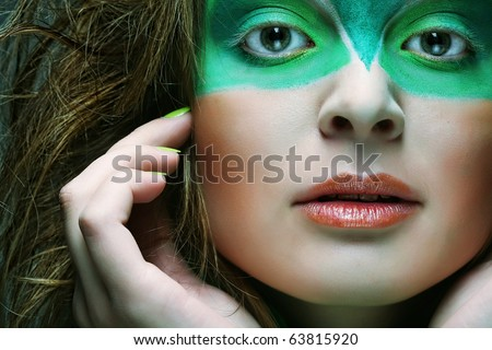 woman with green creative make-up - stock photo