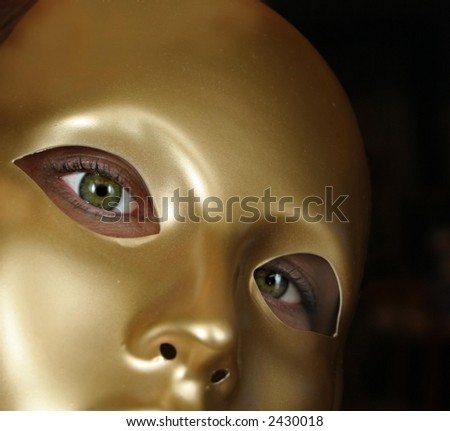 Woman With Green Eyes and Golden Mask - stock photo