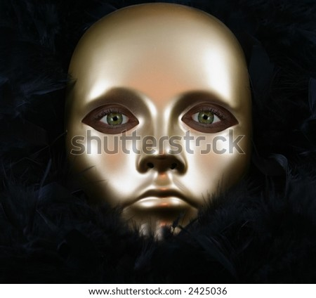 Woman with Green Eyes Wearing Golden Mask and Ostrich Feathers - stock photo