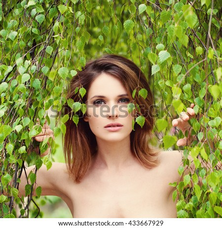 Woman with Green Leaves. Model after the sauna Spa and Sauna Concept - stock photo