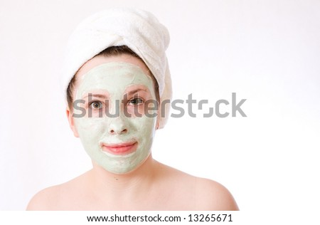 woman with green mask on her face healthy treatment