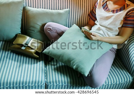 woman with green pillow on sofa, hand play phone,  ,Online shopping,hands holding credit card and using laptop,personal loans, working on his laptop in coffee shop - stock photo