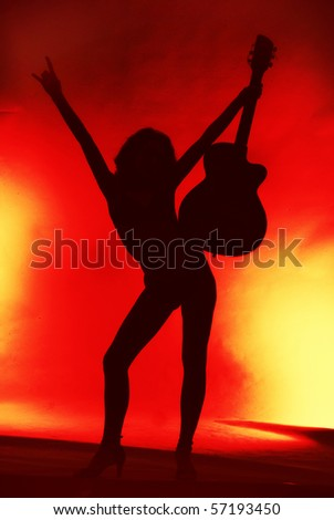Woman with guitar silhouette on red background