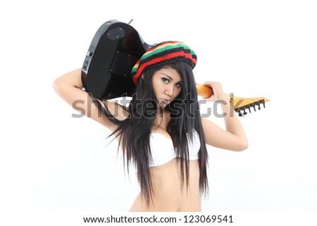 woman with guitar wearing rastafarian hat - stock photo