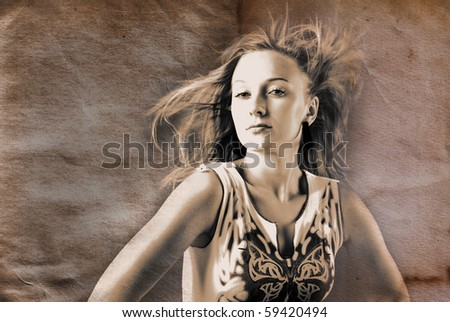 Woman with hair billowing on grunge background