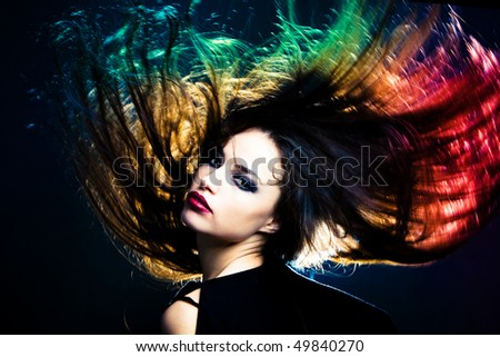 woman with hair in motion, studio shot