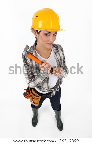 Woman with hammer - stock photo