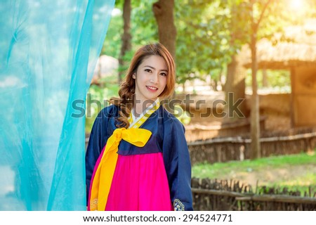 Woman with Hanbok,the traditional Korean dress. - stock photo