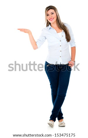 Woman with hand on something displaying imaginary object - isolated over white  - stock photo