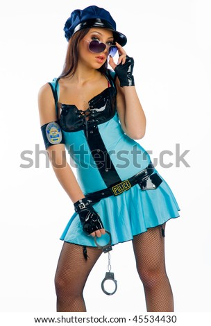 woman with handcuffs wearing policewoman uniform - stock photo