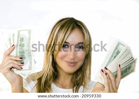 Woman with handful of money, looking pleased with herself on a white background.