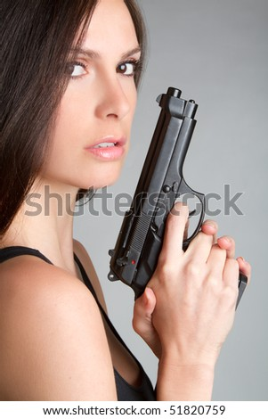 Woman With Handgun - stock photo