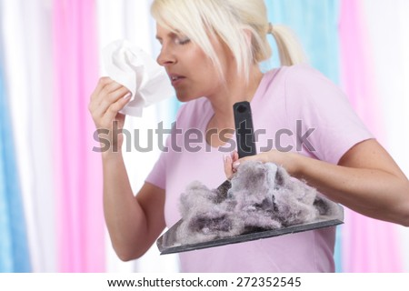 Woman with handkerchief and house dust allergy - stock photo