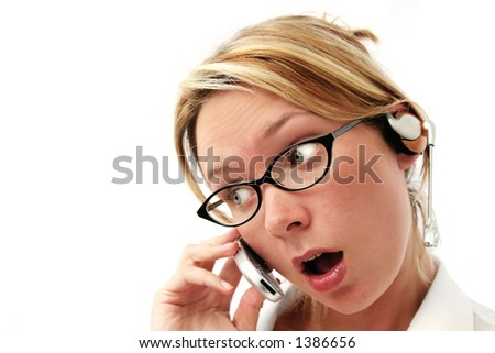Woman with hands free phone kit and surprised expression