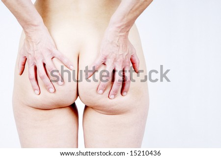 Woman with hands on bottom
