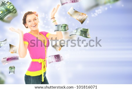 Woman with hands up on the bright blue background. Money flying around her - stock photo