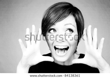 woman with hands up to face shouting something out to you - stock photo