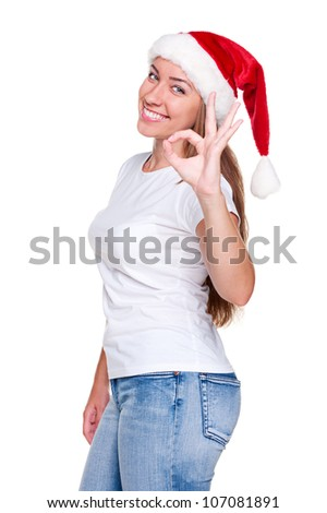 woman with happy smile showing ok sign. christmas theme - stock photo