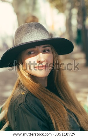 woman with hat enjoying on the street