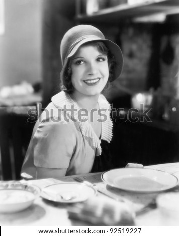 Woman with hat looking charming - stock photo