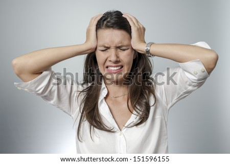 woman with headache and negative face expression - stock photo