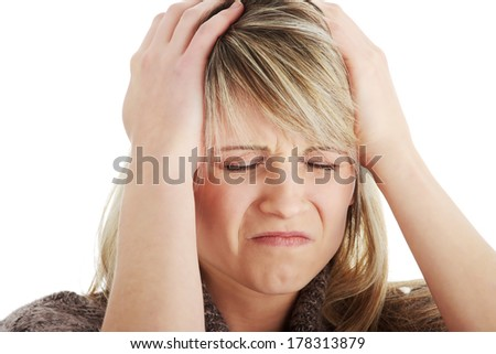 Woman with headache holding her hand to the head, isolated on white